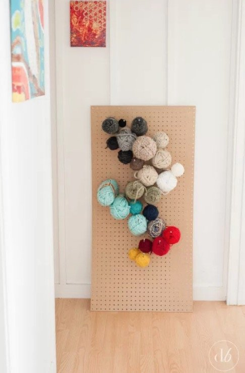 How to Organize and Decorate Any Space with Pegboard- yarn organizer